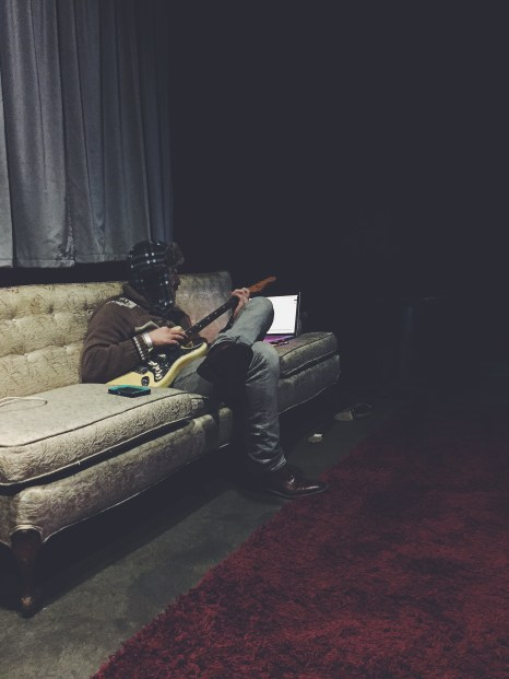 Josh tuning up before their show in Omaha!