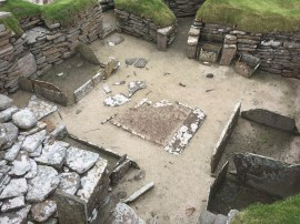 The areas on the left and right with low walls are believed to be beds.