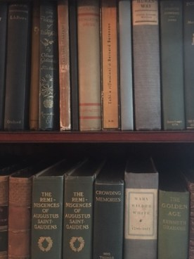 The book in its case in the parlor secretary.