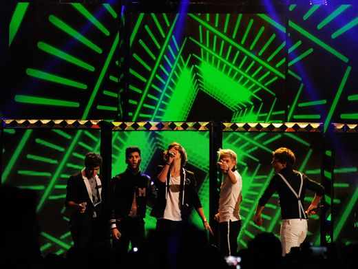Bringing It In|All eyes are on center stage as Harry shows the world why 1D has the 'X-factor!'