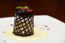 Blueberry cheesecake with chocolate lattice in sauce