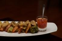 Tempura vegetable platter with glass of sauce