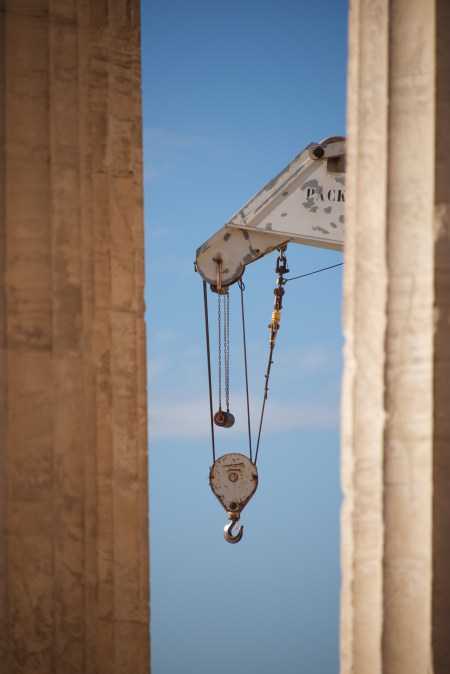 Crane appearing between two marble Parthenon columns