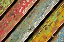 Multicoloured distressed chair back at an angle