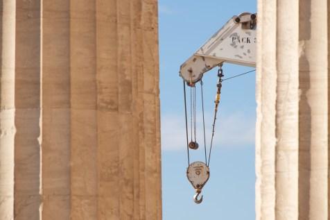 White crane between two marble Parthenon columns