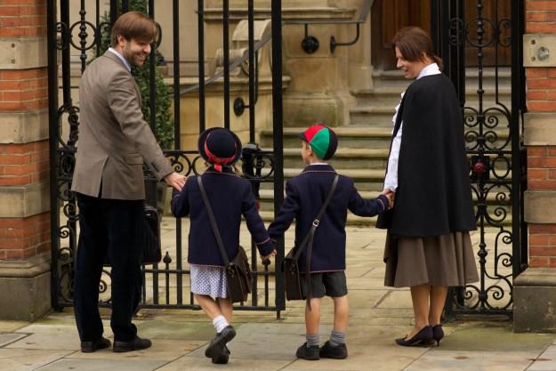 Parents at school gates with children
