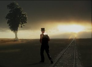 man walking away into the sunset