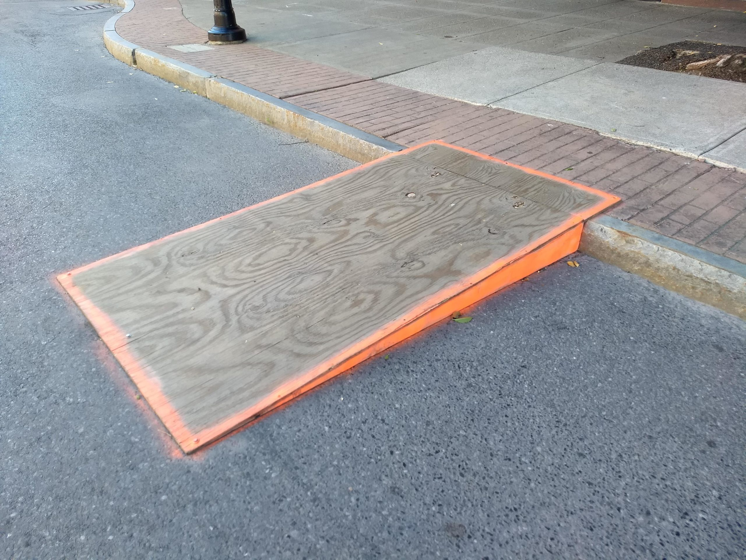 Wooden ramp between sidewalk and Aurora Street