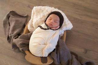 newborn baby boy wrapped in ivory in a studio portrait by MN newborn photographer Nicki Joachim Photography Owatonna Minnesota