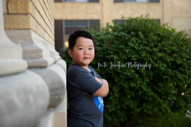 young boy outdoor smiling child portrait by MN family and child photographer Nicki Joachim Photography of Owatonna Minnesota