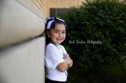 young girl smiling showing school spirit child outdoor portrait by MN family and child photographer Nicki Joachim Photography of Owatonna Minnesota