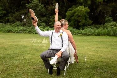 bride and groom overjoyed at country chic wedding in portrait by MN wedding photographer Nicki Joachim Photography of Owatonna Minnesota