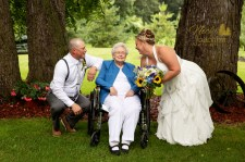 bride and groom smiling with grandma at their outdoor rustic wedding portrait by MN wedding photographer Nicki Joachim Photography of Owatonna Minnesota