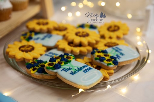 tasty custom cookies wedding dessert in country chic wedding portrait by MN wedding photographer Nicki Joachim Photography of Owatonna Minnesota