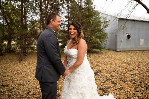 Bride and Groom candid portrait at outdoor rustic country wedding in Kasson MN by MN Wedding Photographer Nicki Joachim Photography of Owatonna, Minnesota