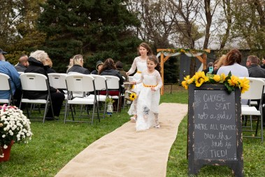 Flower girls at outdoor rustic country wedding in Kasson MN by MN Wedding Photographer Nicki Joachim Photography of Owatonna Minnesota