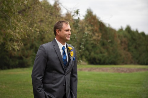 Groom at outdoor country wedding in Kasson MN by MN Wedding Photographer Nicki Joachim Photography of Owatonna Minnesota