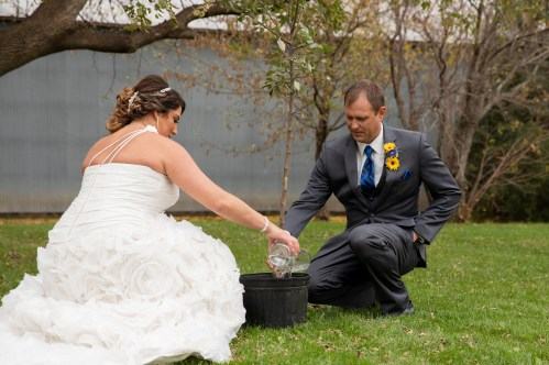 Unity tree watering at outdoor country wedding in Kasson MN by MN Wedding Photographer Nicki Joachim Photography of Owatonna Minnesota