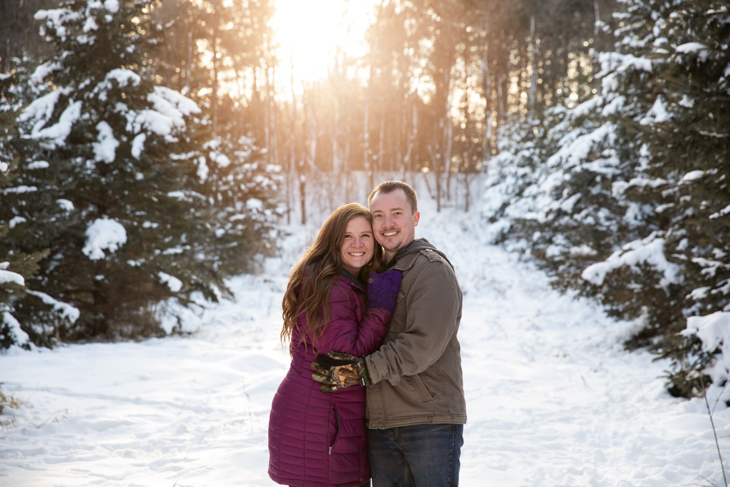 Winter sunset couples portrait in a family photo session by MN Family Photographer Nicki Joachim Photography of Owatonna, Minnesota