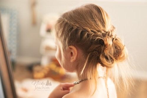 young girl's boho updo in lifestyle portrait by MN Wedding Photographer Nicki Joachim Photography of Owatonna, Minnesota