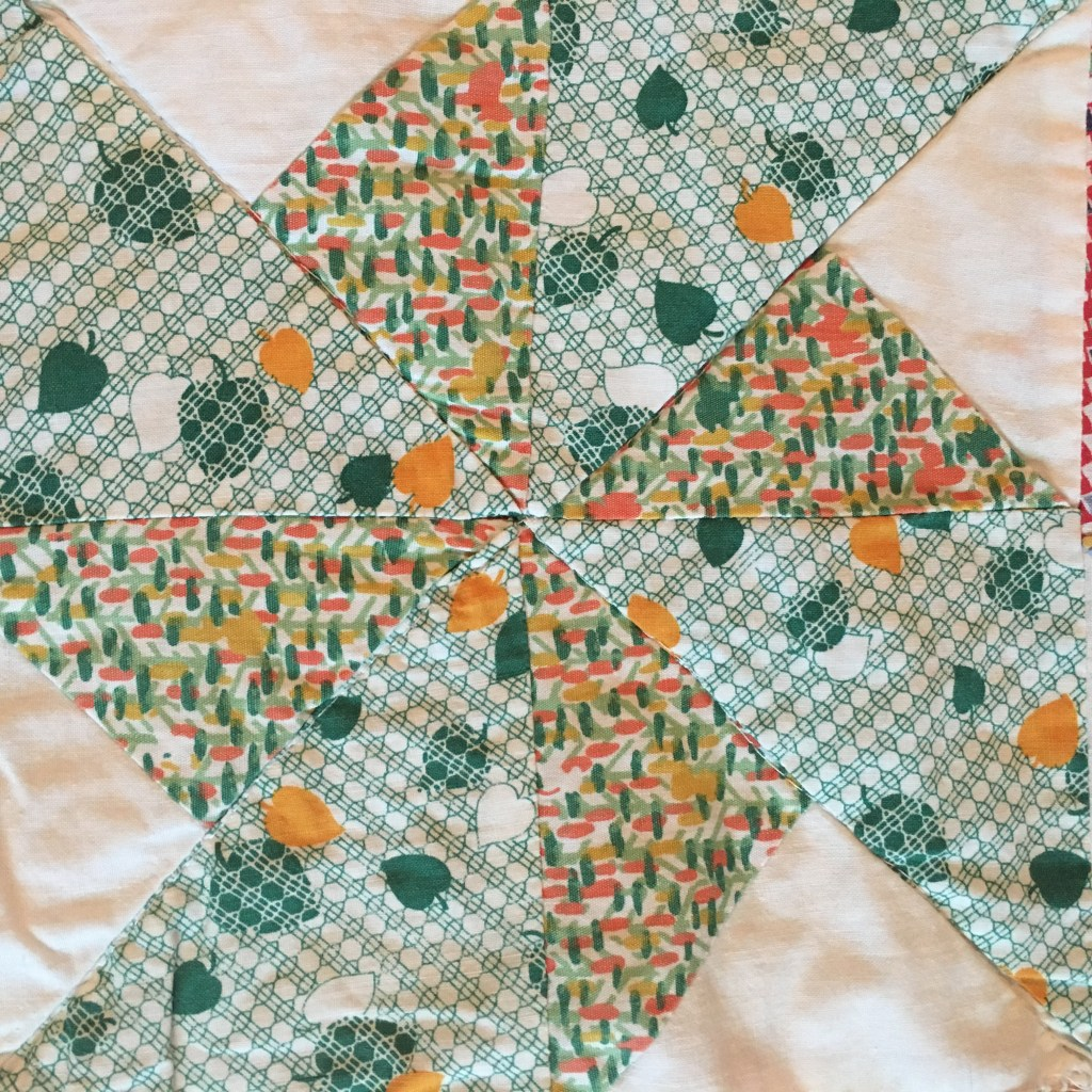 This block is part of a complete scrappy double pinwheel quilt I made from fabrics handed down by my great-great-grandmother. Click to see the whole quilt...