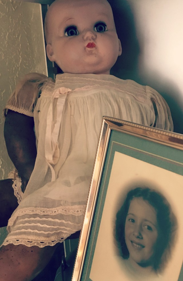 vintage baby doll and child's photo in family museum