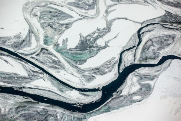 River flowing through snow in the Icelandic wilderness