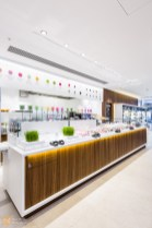 Wooden panelling dominates the servery with bright, bold signage behind