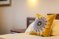 Floral cushions set off the room's colour scheme