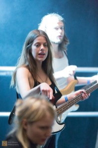 Ása Dýradottir, the bassist, discusses the sound with a technician during the sound check