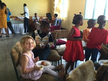 Grace with her friends at a church potluck after communion.
