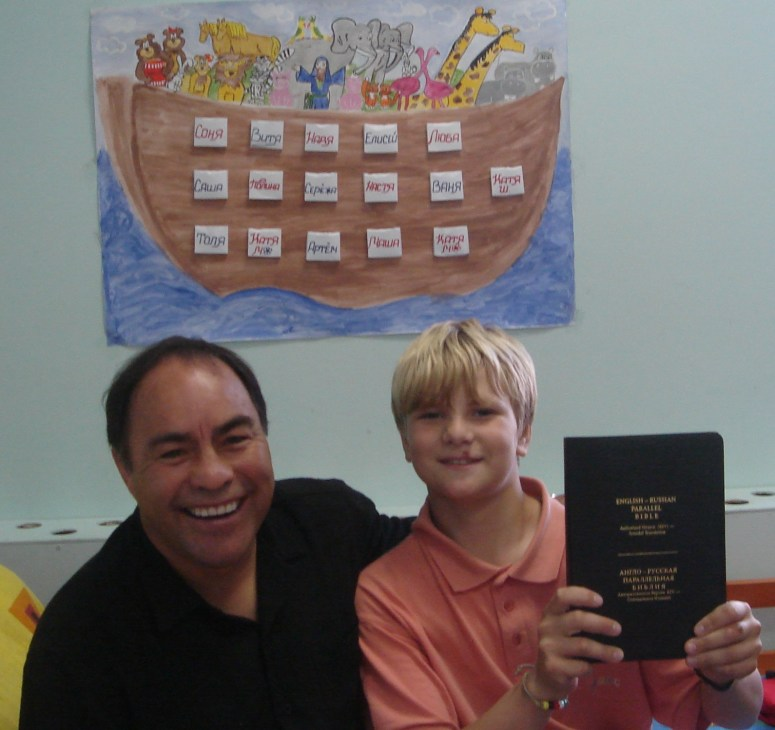 young Robert happy with his bilingual Bible