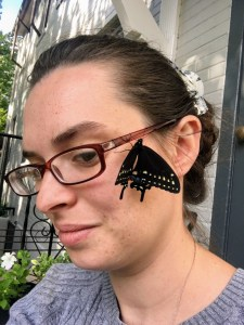 black swallowtail butterfly on face