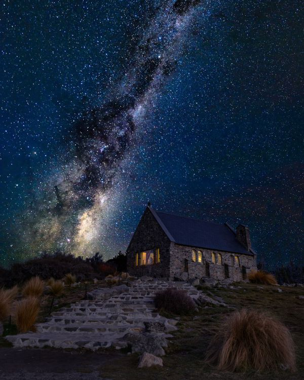 Milky way rising behind the church of good shepherd in Tekapo New Zealand