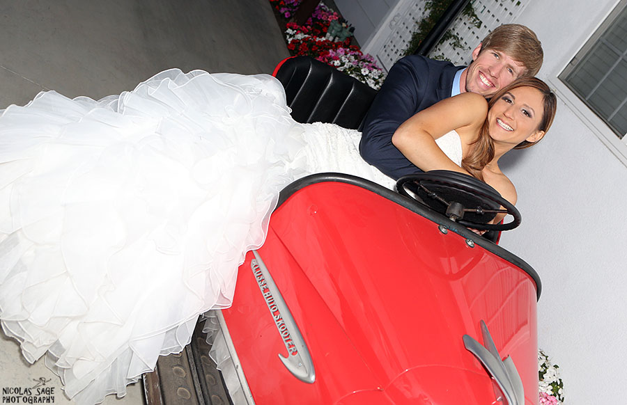 bride and groom in bumper cars at Whittier wedding venue