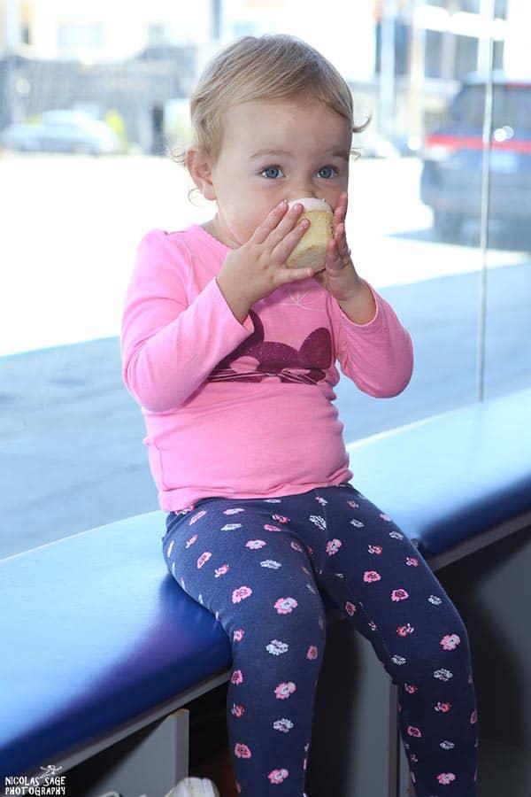 little girl eating cupcake