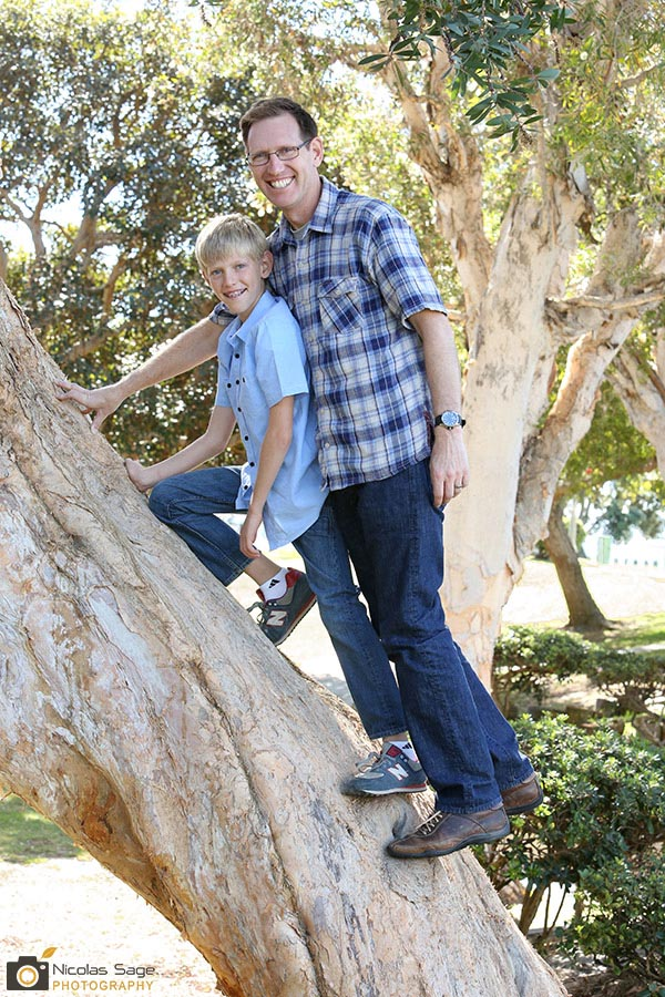 father and son portrait on a tree