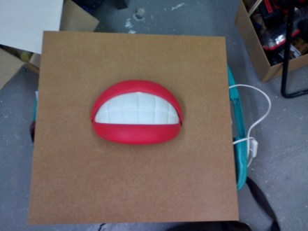 """I might make something out of this mouth-lamp: It would be a 50s-style sign that says """"Service with a Smile!"""""""