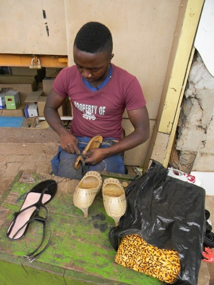 The shoemaker (and the cloth for the dress in the bag)