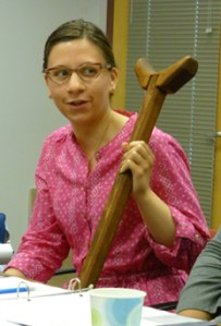 Nicole Belolan explaining her dissertation research with a nineteenth-century crutch in her collection (Photo Courtesy Erik Rau)