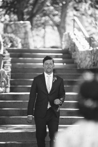 groom first look temecula creek inn wedding stone house bride