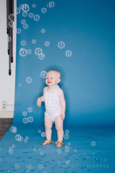 bright-colored-backdrop-studio-family-photo-ideas-nicole-caldwell-07