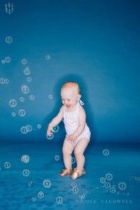 bright-colored-backdrop-studio-family-photo-ideas-nicole-caldwell-09