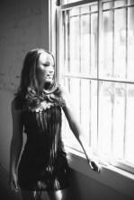 top orange county boudoir photography studio female photographer nicole caldwell boudoir natural light woman by window