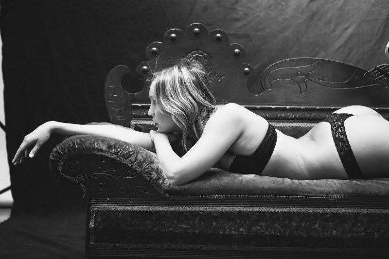 top orange county boudoir photography studio female photographer nicole caldwell boudoir natural light woman laying on couch