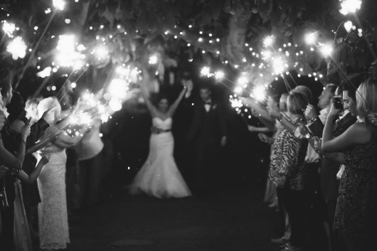 French estate wedding photographer orange reception sparkler farewell