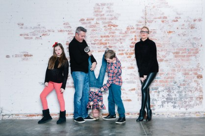 family photography ideas in the studio nicole caldwell brick backdrop 17