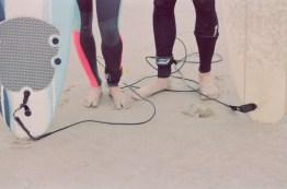 cryatl cove surf couple engagement photos on beach film
