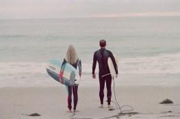 craytsl cove surf couple engagement photos on beach film
