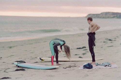surf couple engagement photos on beach film